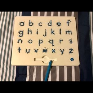 Magnetic Alphabet board with magnetic pen.